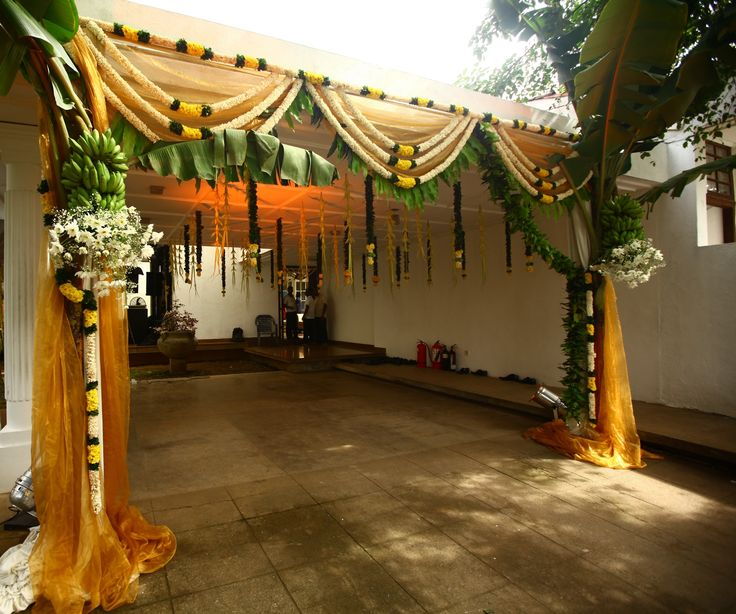Gold fabric and green bananas and leaves use the colour theme for the haldi ceremony