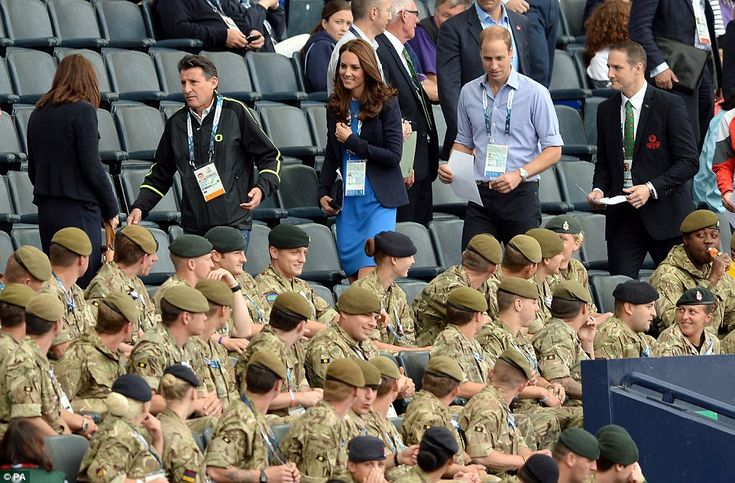 Soldiers gathered to watch the athletics turn to watch the Duchess of Cambridge arrive at Hampden Park with Sebastian Coe (centre left) and Prince William  July 29, 2014