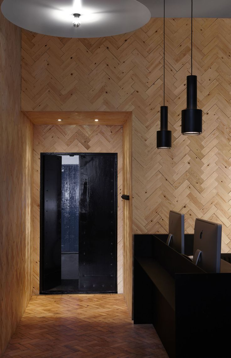 Touch Digital, London by post-office / timber walls / herringbone / black / reception