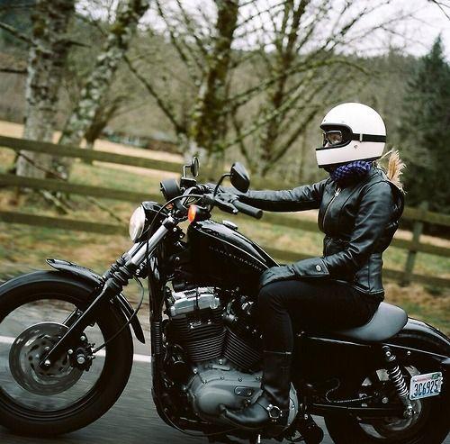 Morgan Gilman Garritson riding a Harley Nightster sporting a...