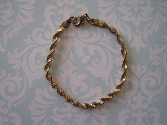 US$8.00 plus shipping!  https://www.etsy.com/ca/listing/209453532/vintage-spiral-gold-toned-bracelet?ref=shop_home_active_22