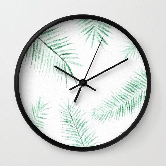 A personal favorite from my Etsy shop https://www.etsy.com/listing/458548510/modern-palm-leaf-wall-clock-modern-wall