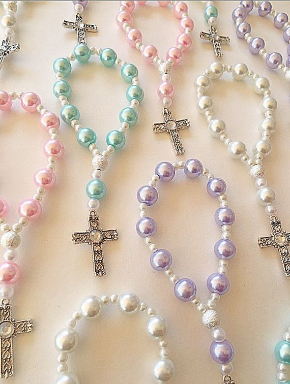 Beautify your special day by giving charming rosary bracelets to your special guest. The bracelets are a perfect way to thank your loved ones for sharing the blessed day with you. It is a keepsake they will have forever and may use often. The bracelets are sold by the dozen or singles. Beautify baptisms, first communions, or give them away to your bridal party as wedding favors.  • Crosses may vary. 3 Lavender 3 Light Blue 3 White 3 Pink