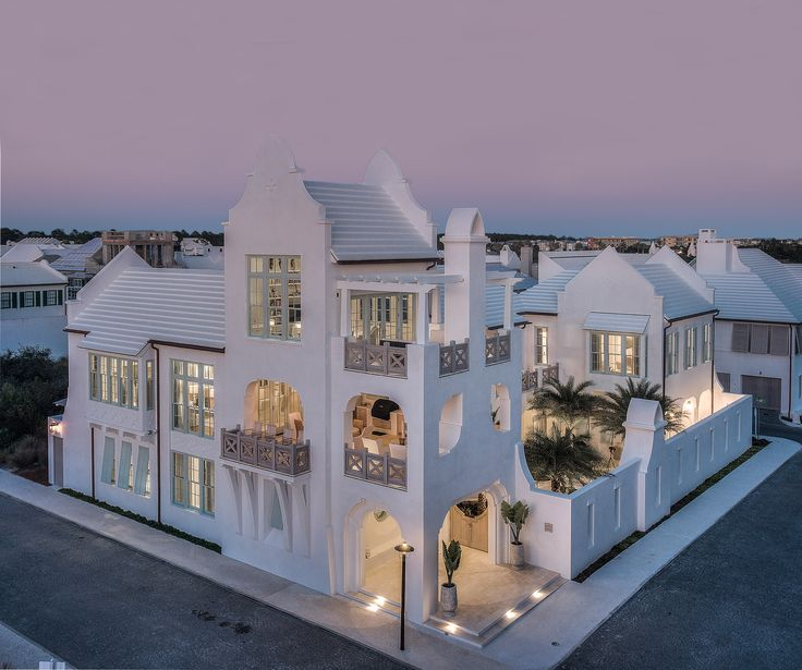 Twilight photography of a Mediterranean style luxury home in Alys Beach