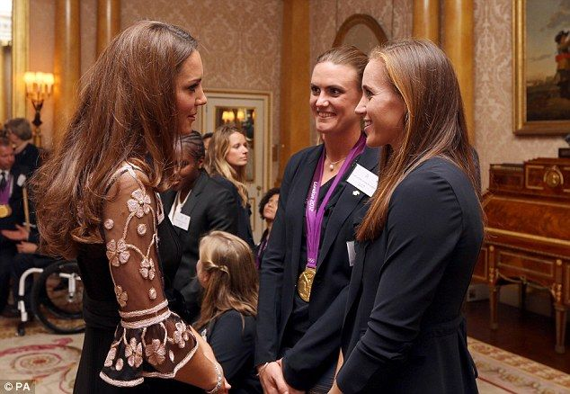 Greeting the champions: The Duchess of Cambridge meets Heather Stanning, centre, and Helen Glover