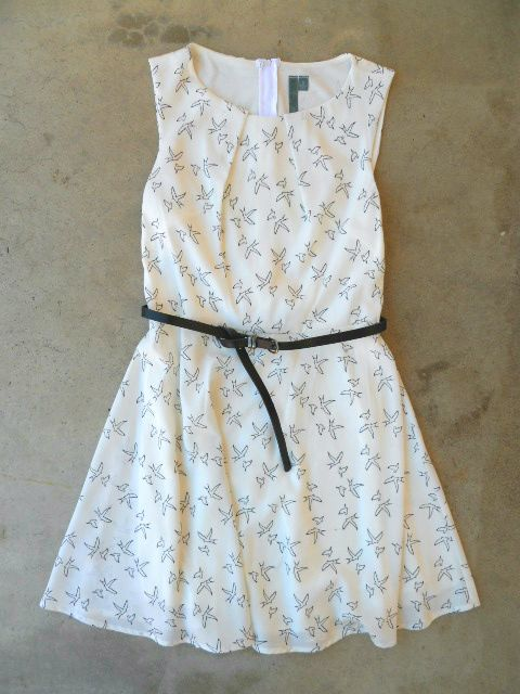 Girly Bird Dress  $42.00  Sweet a-line dress canvassed in a contrasting black and white bird print. Sleeveless frock features a pintuck neckline with a removable/adjustable belt. Hidden back zipper, fully lined. Darling dress, so easy to dress up or down