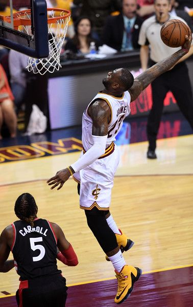 LeBron James Photos - LeBron James #23 of the Cleveland Cavaliers dunks in the second quarter against the Toronto Raptors in game one of the Eastern Conference Finals during the 2016 NBA Playoffs at Quicken Loans Arena on May 17, 2016 in Cleveland, Ohio. NOTE TO USER: User expressly acknowledges and agrees that, by downloading and or using this photograph, User is consenting to the terms and conditions of the Getty Images License Agreement. - Toronto Raptors v Cleveland Cavaliers - Game One
