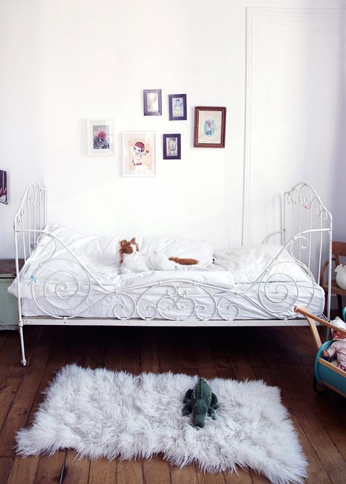 "For their first big-kid bed - get a daybed and put it with the ""back"" side out instead of buying an ugly guardrail."