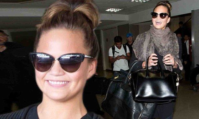 Chrissy Teigen flies to LA after promoting Sports Illustrated cover