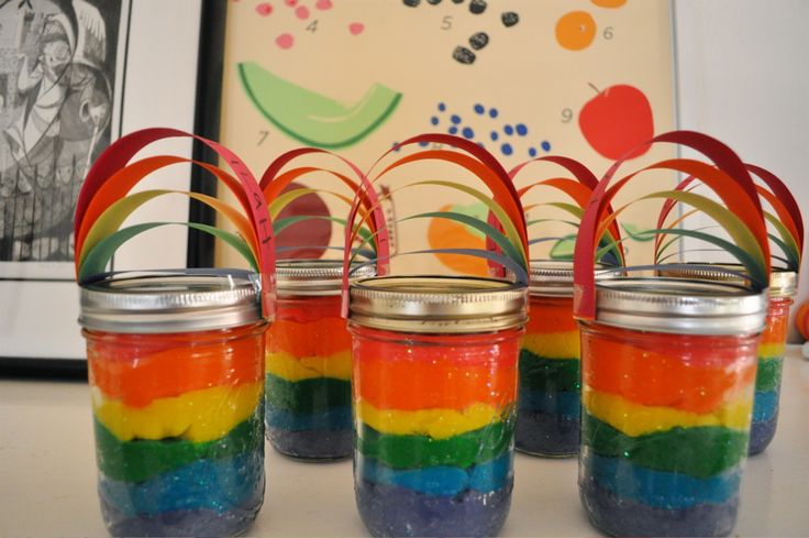 Rainbow party favors - play-doh in jars with rainbow tops  #play-doh