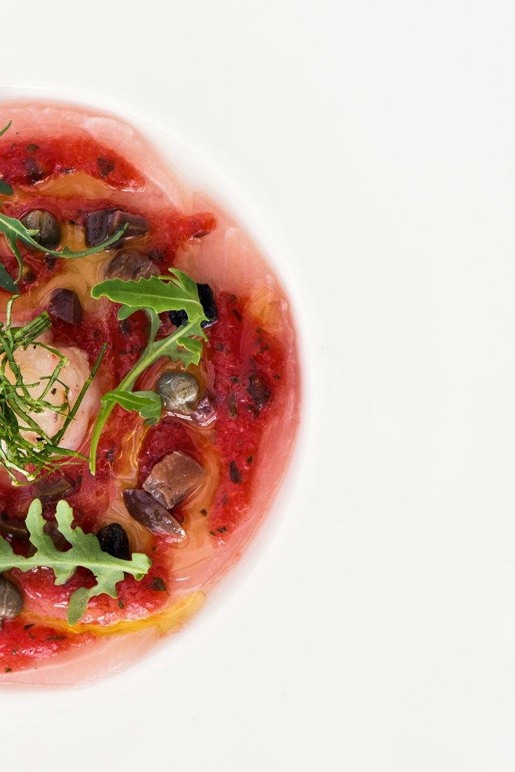 Michelin-starred chef Mauro Uliassi creates a delicious starter using amberjack and raw prawn in this fantastic puttanesca sauce recipe.