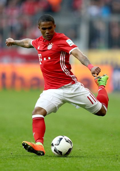 Douglas Costa Photos Photos - Douglas Costa of Bayern Muenchen runs with the ball during the Bundesliga match between Bayern Muenchen and Hamburger SV at Allianz Arena on February 25, 2017 in Munich, Germany. - Bayern Muenchen v Hamburger SV - Bundesliga