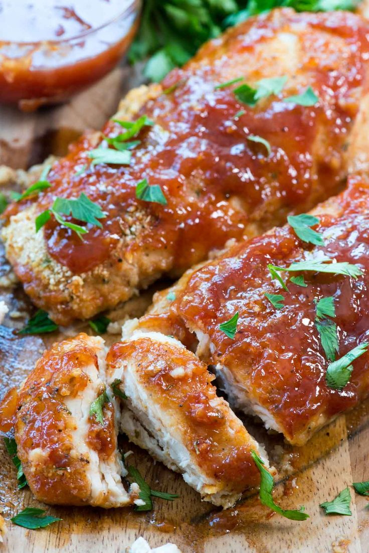 Easy Oven Baked BBQ Chicken - this easy chicken recipe takes is FULL of BBQ sauce flavor and is made in the oven for a quick weeknight meal.