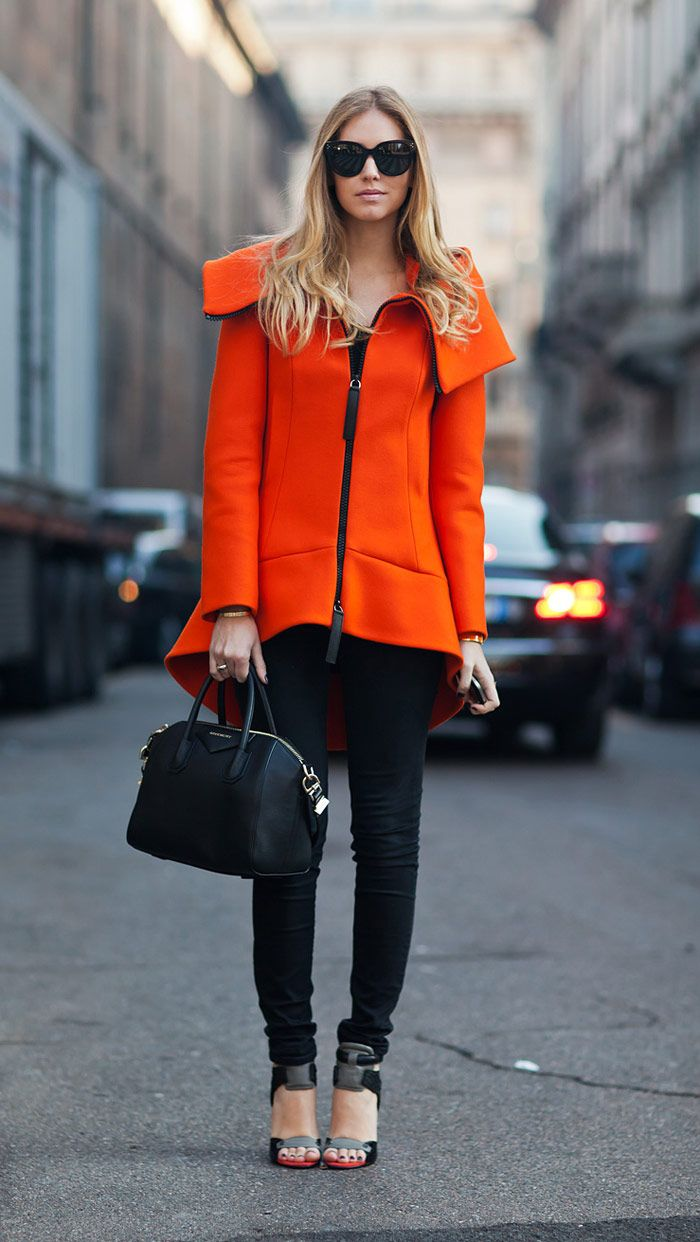 architectural orange coat with jeans