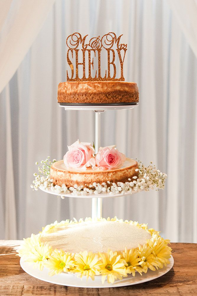 We love this unique naked wedding cake decorated with different flowers and the cutest cake topper! 3Eight Photography captures the moments that you might not be able to fully take in during the busy day! Click the image to learn more about this husband-and-wife photography team. Photo credit: 3Eight Photography