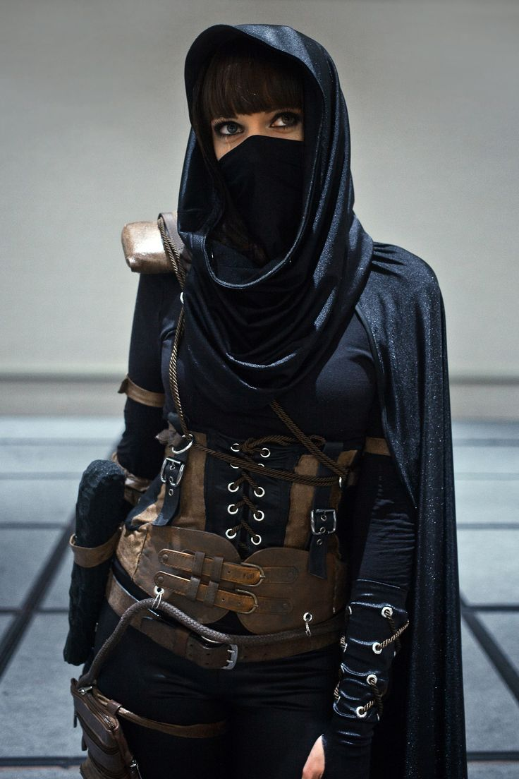 Traveler, she wears the cloak and mask to protect herself from the plentiful dust storms between settlements.