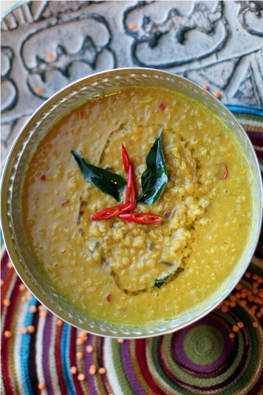 Sri Lankan Style Masur Dal Flavored with Tamarind, Curry Leaves & Coconut Milk -- curry leaves are available in the many Indian groceries around here.