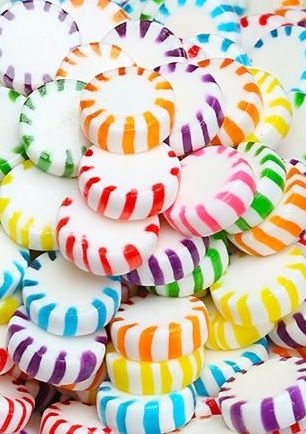 Colourful striped sweets. (Get the starlights here: http://www.candywarehouse.com/products/assorted-fruit-starlights-candy-5lb-bag/)