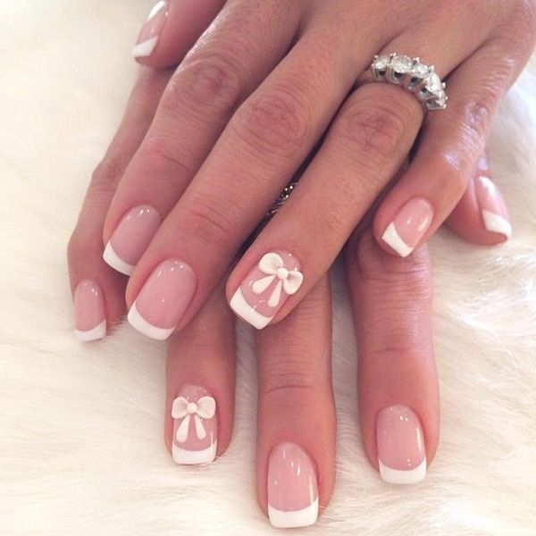 Decorate your nails with French manicure and bows. This little ensemble uses light pink base coating and tipped with pre white polish. The nails are then topped with cute little white bows for a cuter effect.