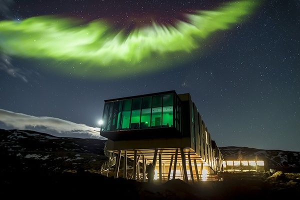 The Northern Lights behind the Ion Luxury Adventure Hotel in Iceland.