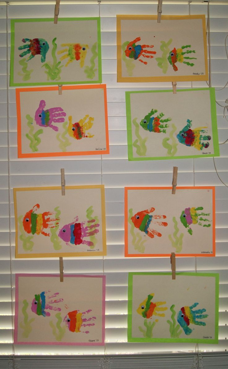 Make one rainbow fish handprint and write the number one to introduce the number one with Rainbow Fish unit
