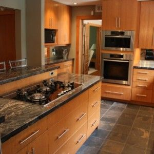 Beautiful kitchen by Laurens Wit Construction. Ottawa. Granite, wood, stainless.