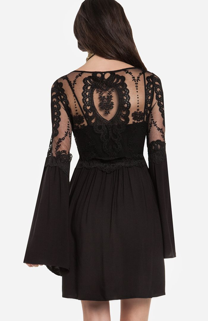 Isabella Dress in black by For Love & Lemons $200 @DAILYLOOK. [Back] Fit and flare dress featuring a sheer lace bodice, half lace half fabric bell sleeves, an elasticized waist. Unlined. Slips on over head. Shown with our Seamless Cami. Length: 33 in. Bust: 31 in. Waist: 30 in. Hip: 50 in. Sleeve length: 26.5 in. Measured from size small. Model Meas: Height: 5'8 / Bust: 32A / Waist: 24 in. / Hip: 34 in. Self: 100% Rayon. Lining: 100% Polyester. Dry clean.