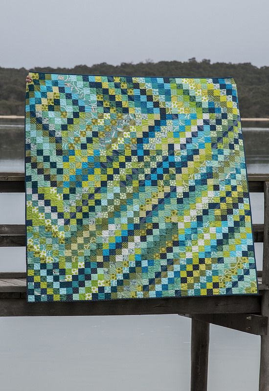 Ripples | by RachelPryer. Like this scrappy Trip Around the World quilt setting…