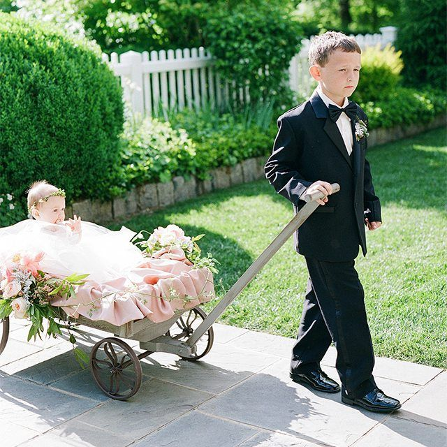 Is your flower girl a little too little to walk down the aisle? We love this super cute solution!