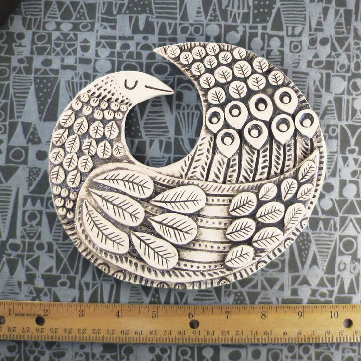 Round bird wall plaque. Scandinavian Mod style via Etsy.