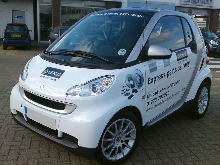 Mercedes Brighton Part's Smart car with printed vinyl graphics.