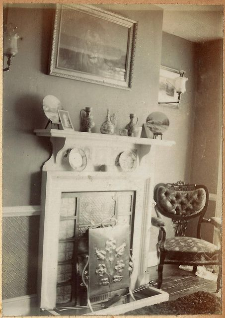 Delightful Edwardian Interior Shot With Picture Of Lion Above Fireplace