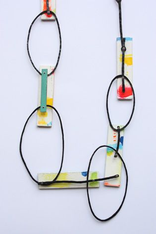 Necklace in steel, wood, aluminium, paper, rope, paint and silver by Réka Fekete