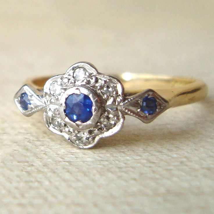 Art Deco Sapphire & Diamond Engagement Ring, Vintage Sapphire Ring, Sapphire Daisy 18k Gold Ring, Approximate Size US 6.75 / 7. $525.00, via Etsy.