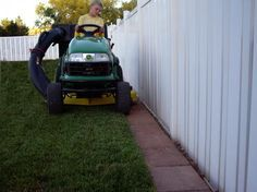 Fence edge. No more weed whacking, or sneaky dogs digging a tunnel to China!