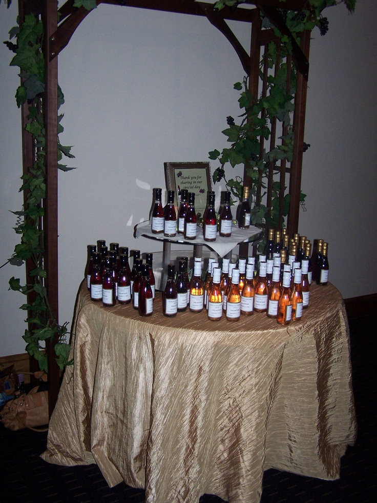 Personalized mini wine bottle favors for a vineyard themed wedding by Amy Nixon Events.