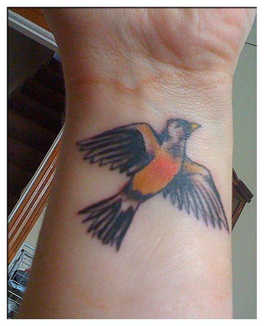 Robin bird tattoo by treadinglightlyrobin, via Flickr
