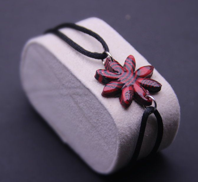 Bracelet with red flower pattern spirals