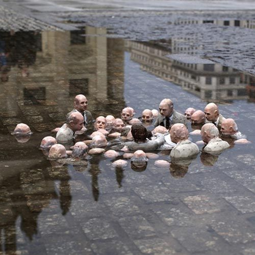 sculpture by Issac Cordal in Berlin . called Politicians discussing global warming