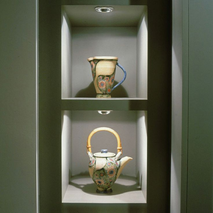 Ornamental jug and teapot lit in niches by LED Eyelid under cupboard lights - http://www.johncullenlighting.co.uk/products/featured-lighting-products/led-eyelid-under-cupboard-light-2/?product_search=eyelid