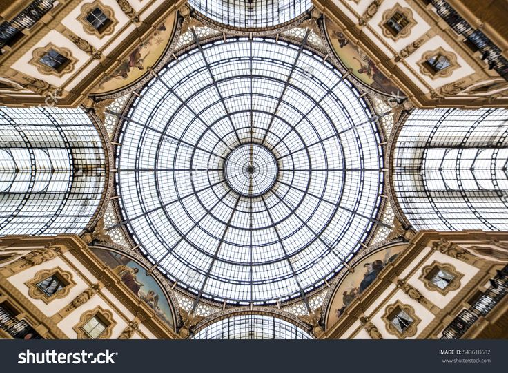 MILAN, ITALY - SEPTEMBER 22, 2016: Glass dome of Galleria Vittorio Emanuele II shopping gallery.