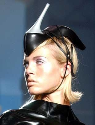 Shoe hat. Kudos to the model for maintaining a 'haute couture' facial expression.