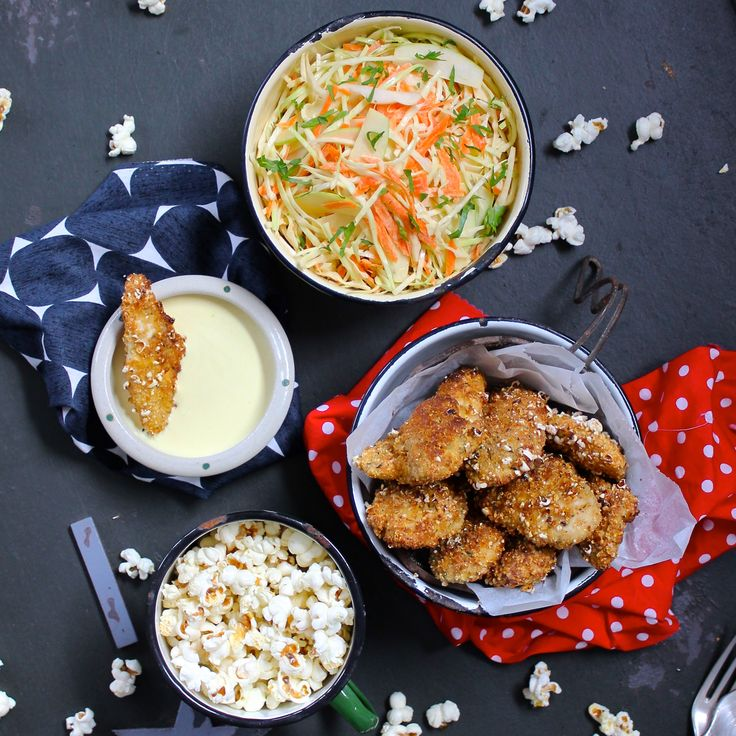 SOUTHERN STYLE POPCORN CHICKEN & SLAW. If you and your family have a soft spot for fried chicken but don't like the grease and guilt, then you will love this recipe... Free range chicken strips coated in freshly popped popcorn and grilled in the oven until golden. Served with a classic Southern slaw. YUM! 30 Minutes. Free Range. So much fun to make.