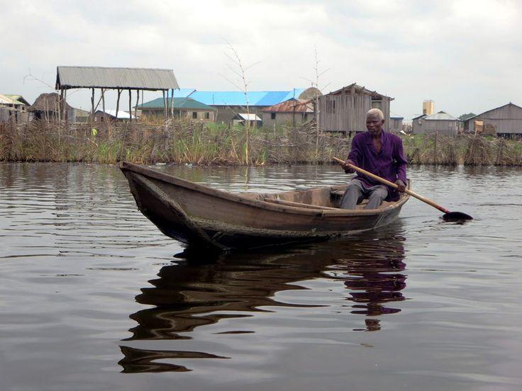 A Tofinu man out for a paddle at Ganvie village on Lake Nokoue near Cotonou, Benin.