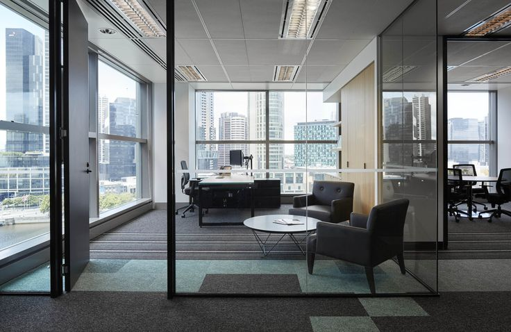 M2 Telecommunication - use of patterned flooring and glass for private executive office. By STUDIOMINT Melbourne Australia