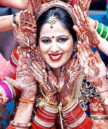 Mehendi adorned bride