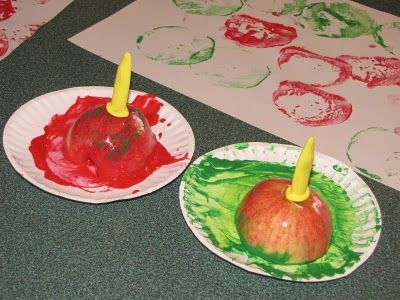 Apple Prints - use corn on the cob holders to make it easier to stamp with.  why haven't I thought of this before???