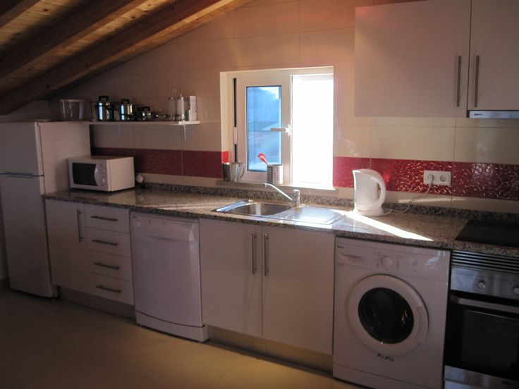 Fully equipped kitchen with large Fridge freezer, dishwasher,washing machine, microwave oven, electric hob and oven