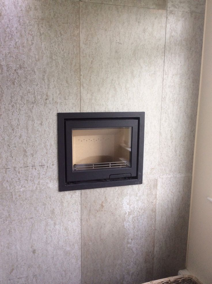 Contura i6 insert stove with concrete wall panels from concreate