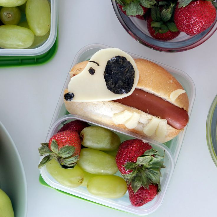 """To celebrate Charlie Brown and the Peanuts gang going 3D on the big screen, we're doing it the only way we know how: by making Snoopy hot dogs! You (or your kids) will go crazy for these sweet bento box lunches and, unlike Charlie Brown, won't say, """"Why can't I have a normal dog like everyone else?"""" From Bento Monsters Hot Dog Bento Ingredients1 hot dog 2 small hot dog buns 2 slices white american cheese 1 slice nori seaweed sheets Directions Boil hot dogs until cooked through and then cut…"""